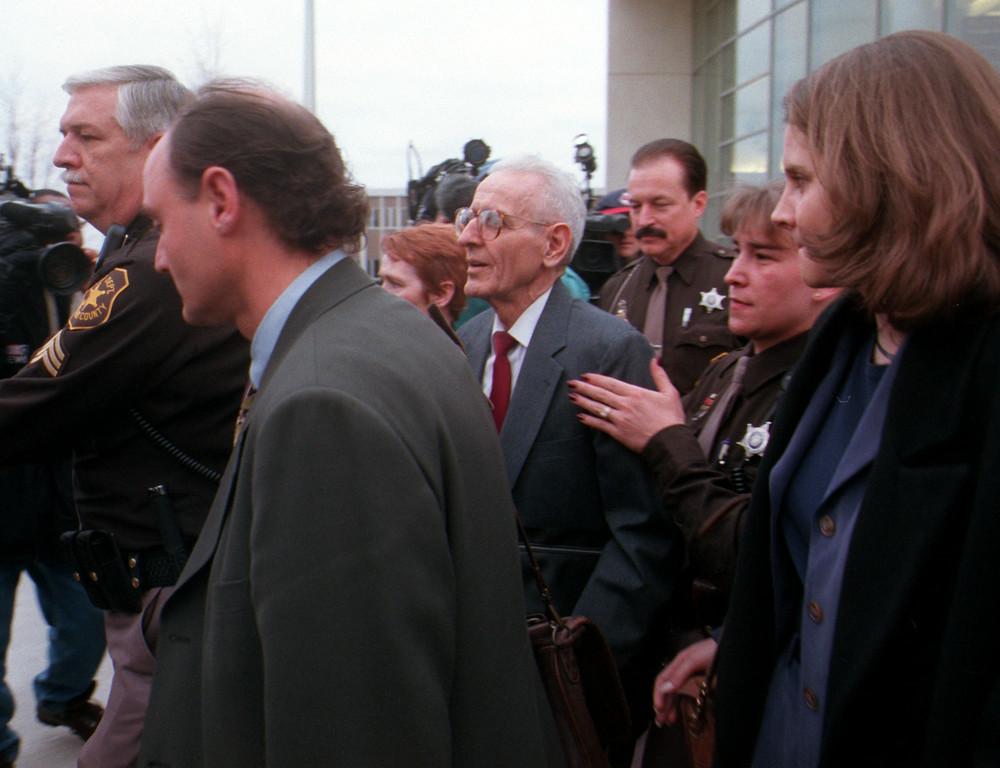 Description of . Dr. Jack Kevorkian leaves Oakland County Circuit Court under heavy security after the jury failed to come to a verdict after their first day of deliberations in his murder case Thursday.