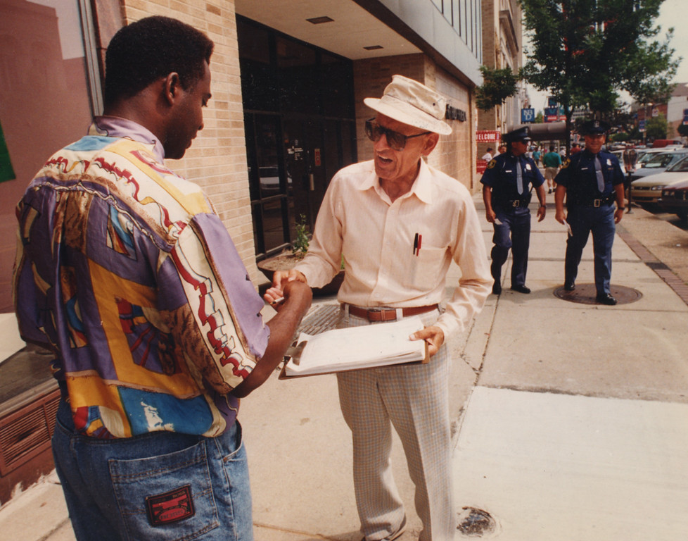 Description of . 6/22/1994- Dr. Kevorkian gets people to sign his petition along Saginaw St. in Pontiac regarding a ballot issue.