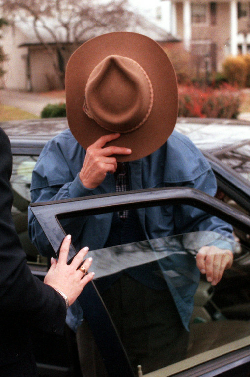 Description of . Jack Kevorkian shields his face as he arrives at his legal council's home, Robert Sedler, before the announcement by Oakland County Prosecutor David Gorcyca of charges against him in the death of Thomas Youk, of Waterford.