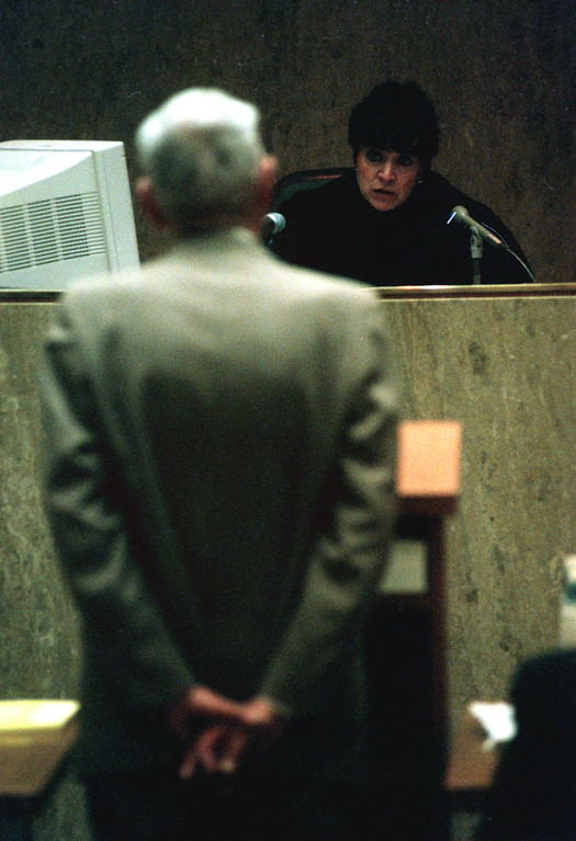 Description of . Oakland County Circuit Court Judge Jessica Cooper listens to Dr. Jack Kevorkian as he announces that he will represent himself during his murder trial.