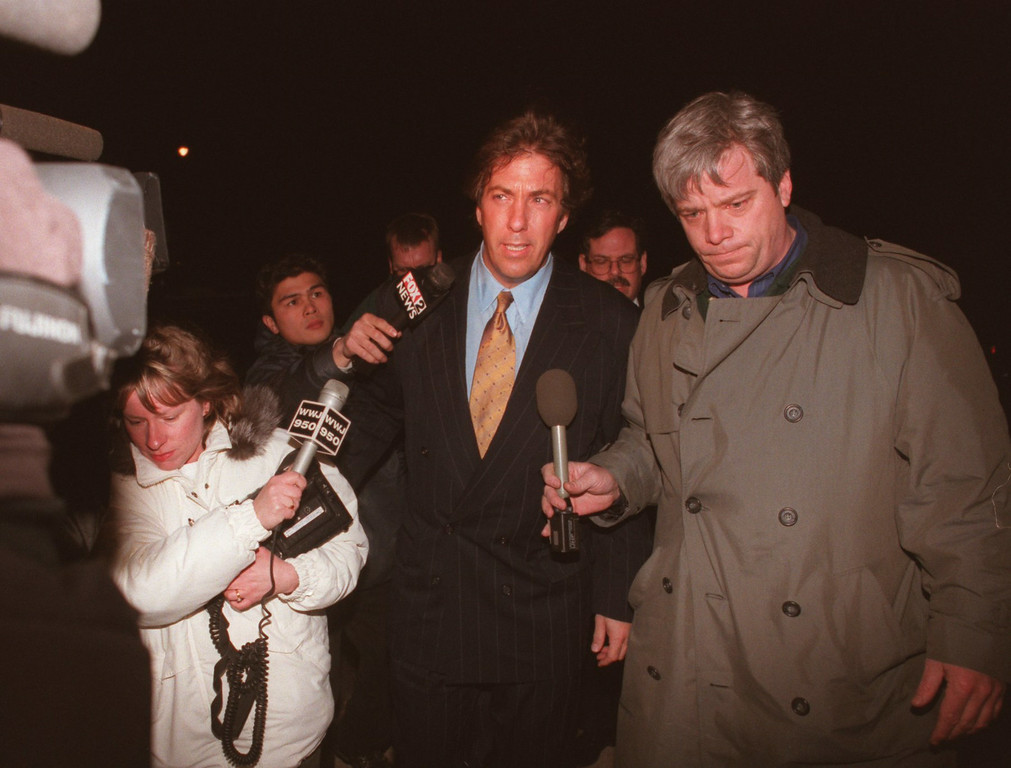 Description of . Media surrounds Fieger as he arrives at the Embasy Tower Apts. in Southfield,  where Jack Kevorkian helped Rossevelt Dawson commit suicide.