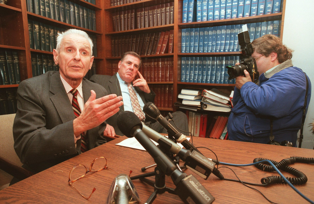 Description of . Dr. Jack Kevorkian, left, Neil Nicol, right, medical technician and Dr. George Reading (not shown) held a press conference odering a ban on assisted suicide.