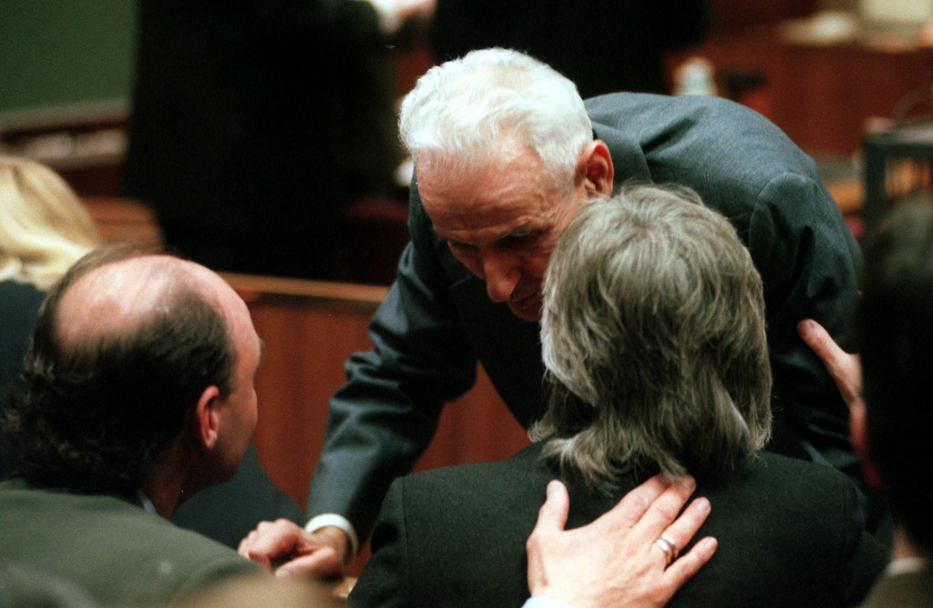 Description of . Doctor Jack Kevorkian chats with Terrance Youk, left, brother of Thomas Youk and Melody Youk, wife of Thomas Youk during a short resess in Oakland County court.  Kevorkian is chared with first-degree murder for the lethal injection death of Thomas Youk.