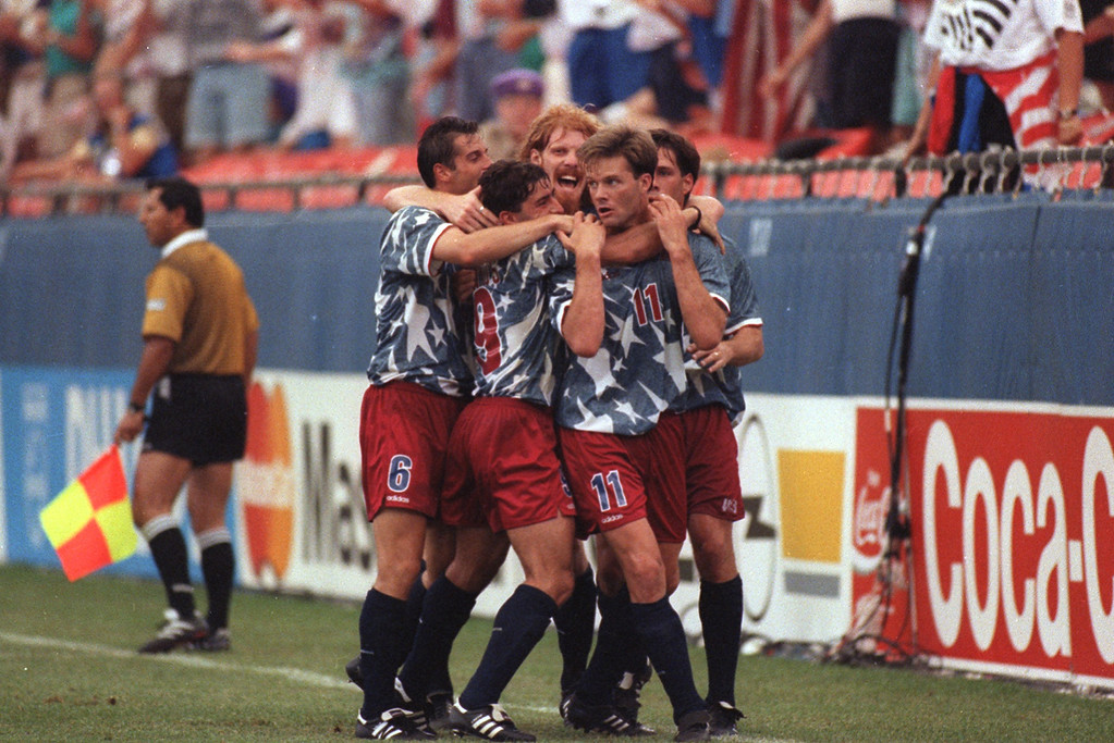 Description of . (FILE PHOTO)-- U.S. players celebrating a 1-1 tie against Switzerland in the first-ever World Cup game played indoors at the Pontiac Silverdome in 1994.