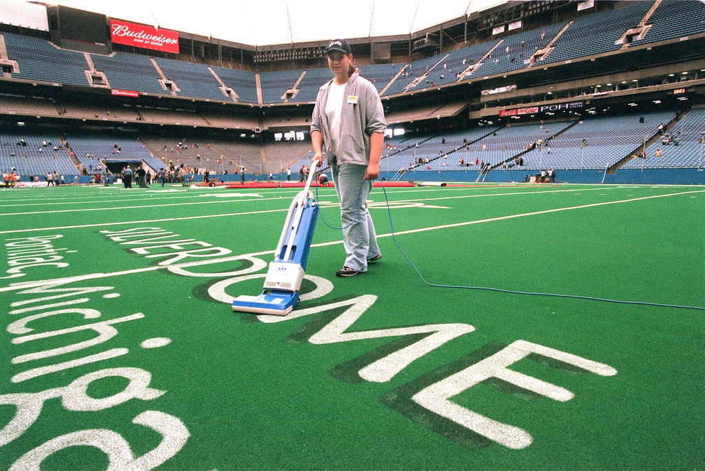 Description of . Stacey Ivey from Brighton, Mi. vacuums the Silverdome carpet getting ready for the Jehovah's Witness  annual conference set for this weekend.