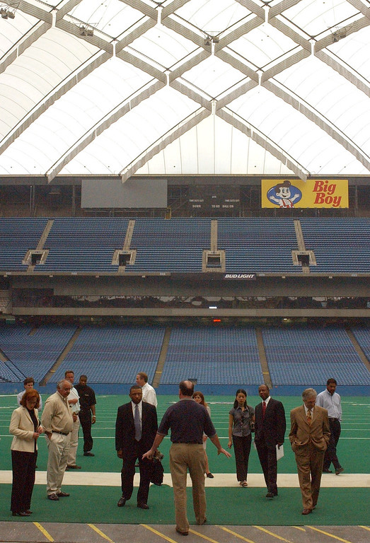 Description of . John Kissick, center, director of operations at the Pontiac Silverdome leads a group during a walking tour of the faculity on Monday. The city of Pontiac and Pontiac Silverdome officals are soliciting offers for the property, since the Detroit Lions vacated the property for their new $315 million indoor venue located in down town Detroit.