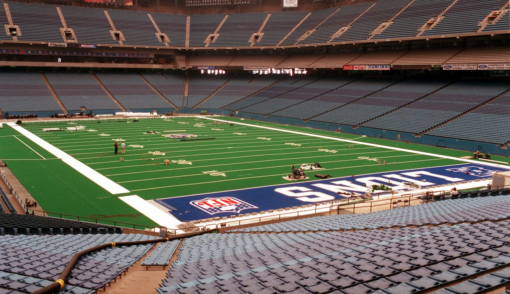 Description of . New artificial turf being installed at the Silverdome.