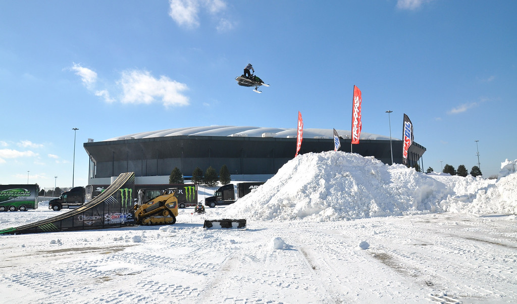 Description of . Jeff Mullin of Ontario, jumps his snowmobile outside the Pontiac Silverdome, to promote the AMSOIL Championship Snocross Series (ACSS) racing event on Saturday Feb. 12, 2011 when the worldÕs top snowmobile racers will get after it on an indoor snocross racetrack.