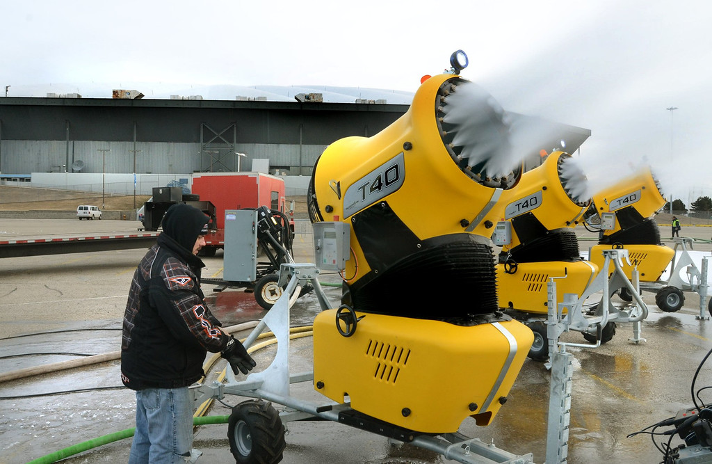 Description of . ***WITH VIDEO*** Scott Sivula of ISOC Racing adjust the snow guns in the parking lot of the Pontiac Silverdome. They will truck the snow inside starting Thursday.  The Silverdome will be the home of this weekends the ISOC  AMSOIL Championship Snocross Series with opening ceremonies at 7 pm on Saturday.  Tickets start at $10.00.  The Oakland Press/TIM THOMPSON