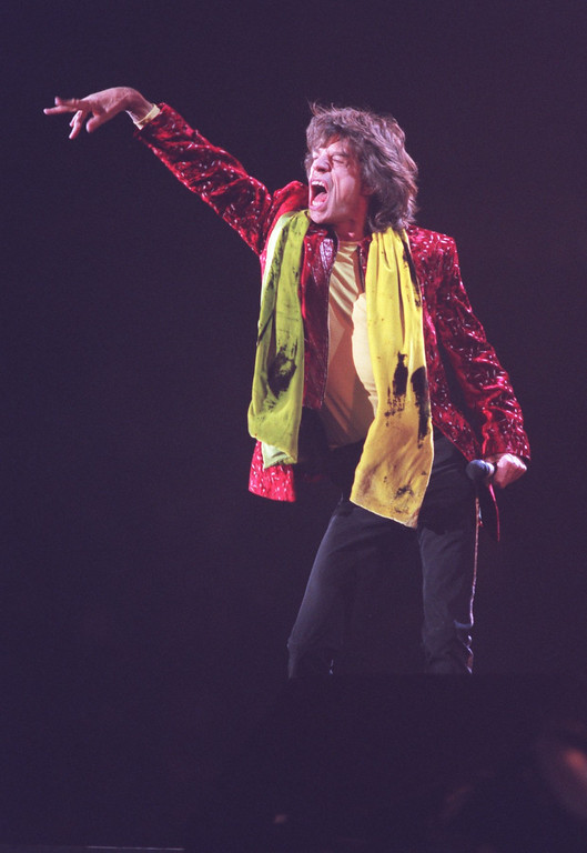 Description of . Rolling Stones lead singer Mick Jagger wows the crowd during the band's opening song,