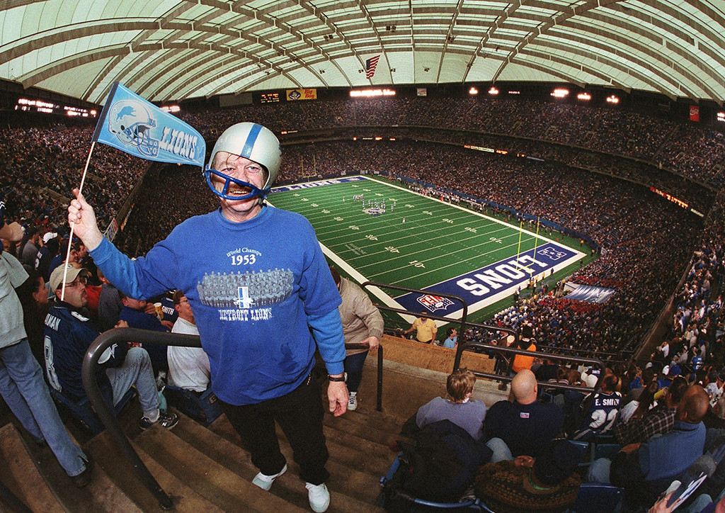 Description of . Lions fan Dennis Chapin cheers on the Lions during the last game at the Silverdome against the Dallas Cowboys Sunday January 6, 2002.