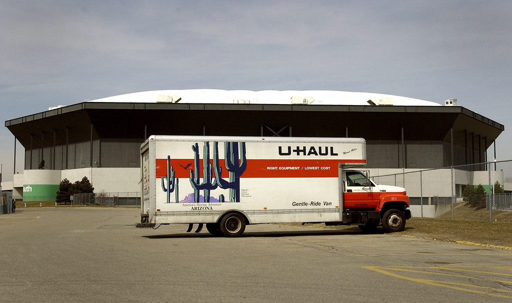 Description of . A U-Haul moving van sits outside of the Pontiac Silverdome.  The Detroit Lions are to be moved out of the Silverdome by Monday, April 1, 2002.