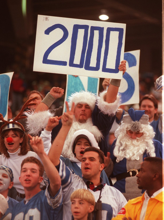 Description of . Fans hoping that Barry Sanders will become the 3rd player in the NFL to rush for 2000 yards in a single season. The Lions were playing the New York Jets at the Pontiac Silverdome.