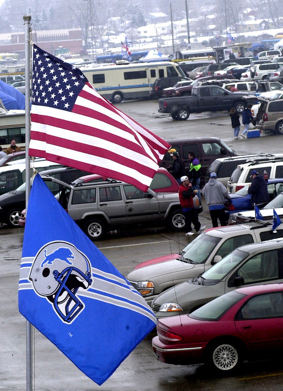 Description of . Fans tailgate in the parking lot of the Pontiac Silverdome prior to the start of Sunday's game against the Dallas Cowboys at the Pontiac Silverdome. The Lions won 15-10 over Dallas to end the season and their final game played at the Silverdome.