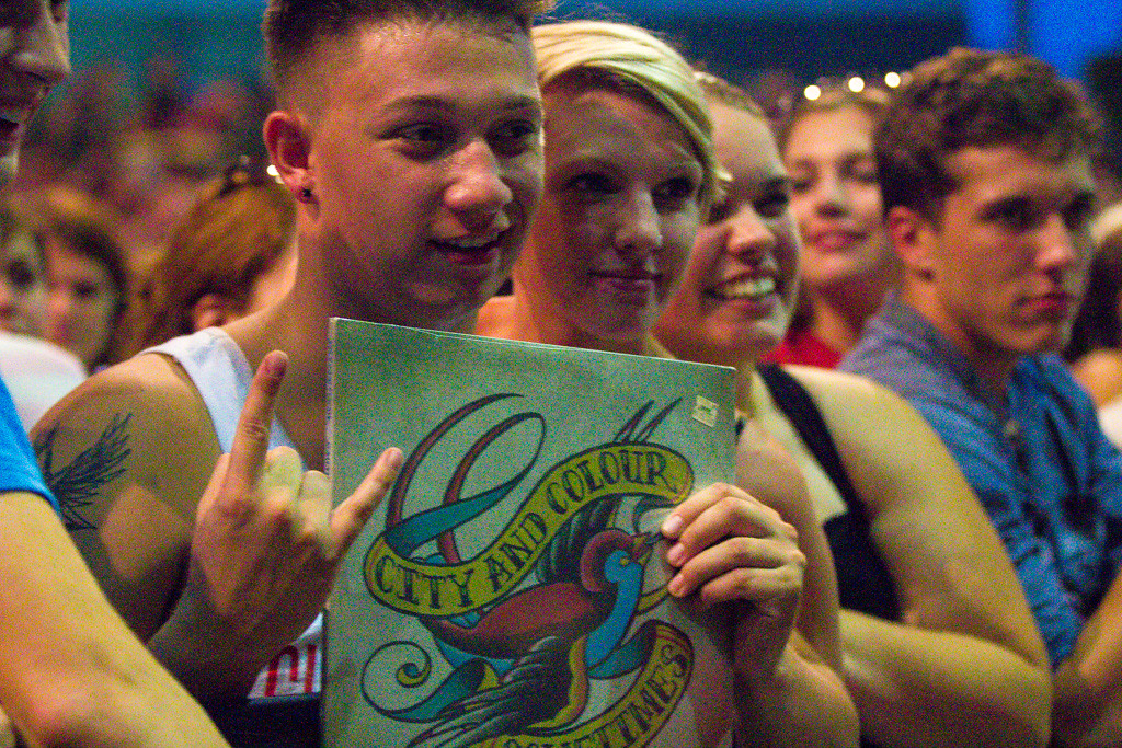 Description of . A fan holds up his City & Colour record during the group's set. - 6/12/2014. Photos by Dylan Dulberg/Special to The Oakland Press