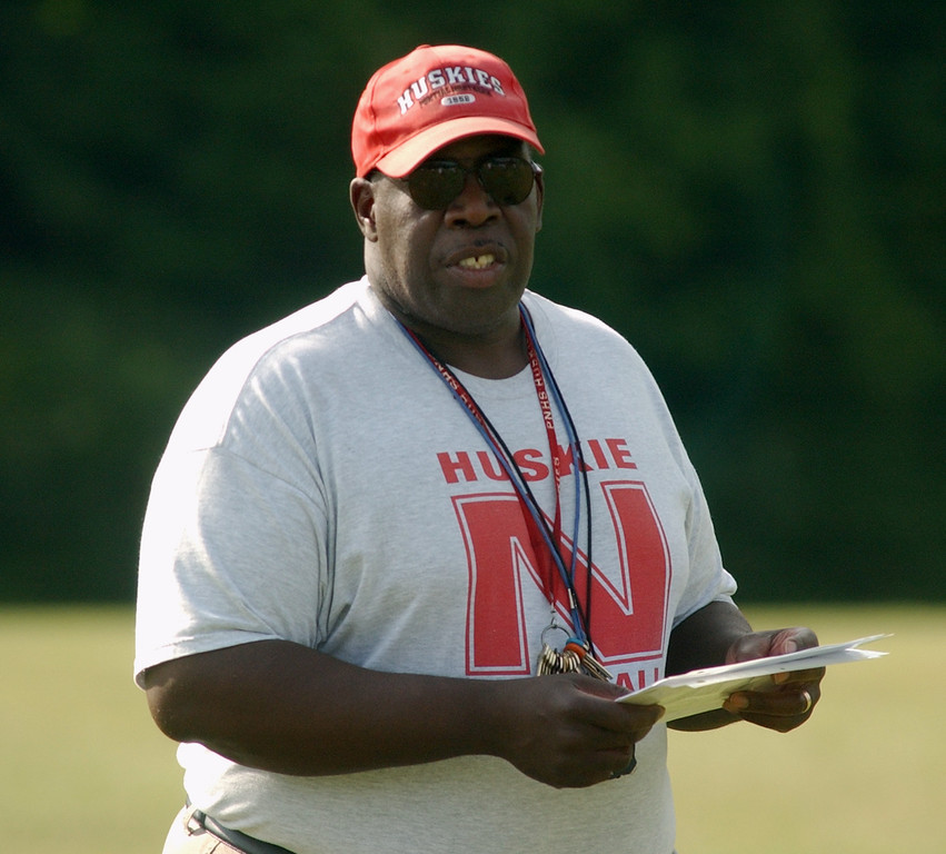 Description of . Pontiac Northern High School football head coach Keith Stephens watches his team practice, Tuesday, August 8, 2006, at Northern HS in Pontiac, Mich.  (The Oakland Press/Jose Juarez)