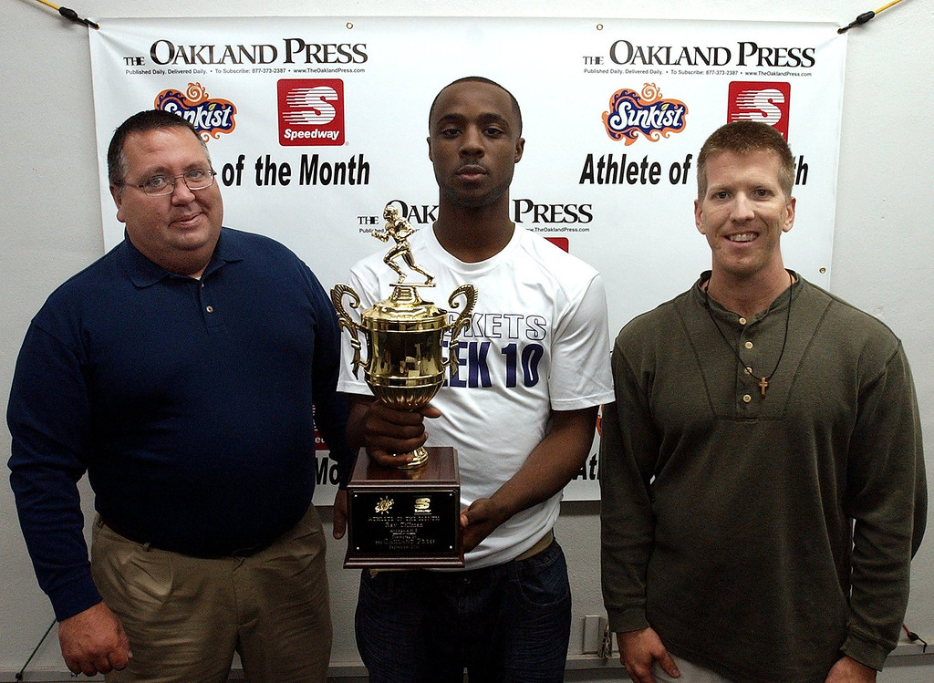 Description of . (from left) Mark Flynn, district manager 7-Up of Detroit, Athlete of the Month  Ray Tillman, Avondale High School football player and Keith Dunlap, Oakland Press sports reporter. (Oakland Press Photo:Vaughn Gurganian)