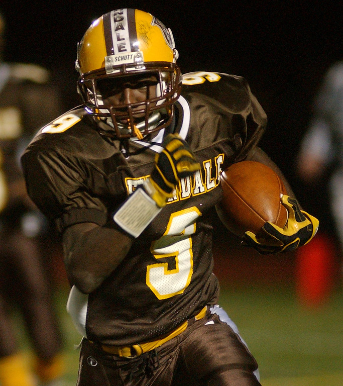 Description of . Ferndale High School football player Brandon Pittman runs for yardage against Bloomfield Hills Lahser during third quarter action, Friday, October 10, 2008, at Ferndale HS in Ferndale, Mich.  (The Oakland Press/Jose Juarez)