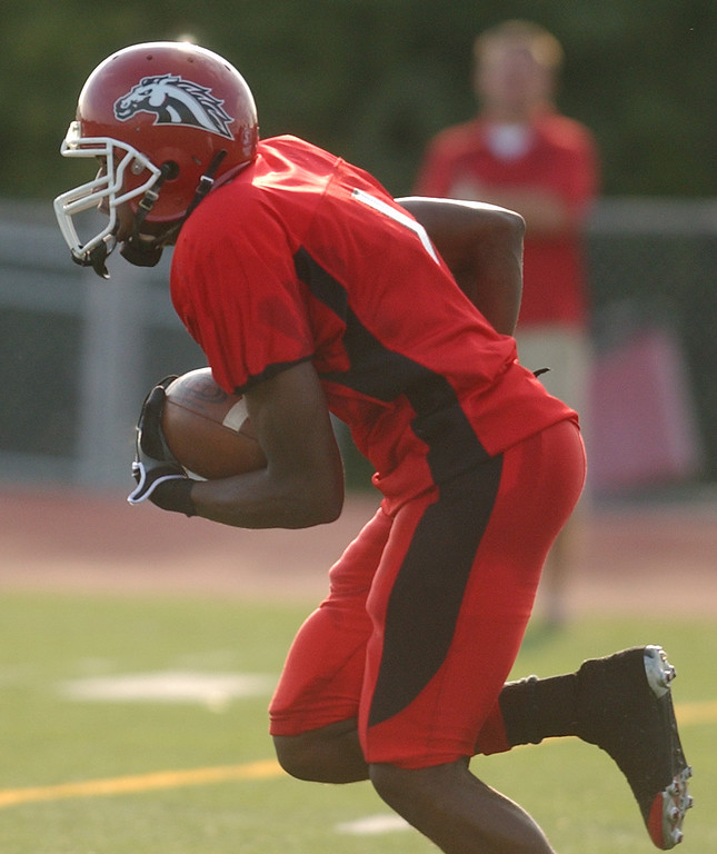 Description of . Southfield Lathrup High School football wide receiver Montrel Robinson runs for yardage against Troy Athens during second quarter action.  Photo taken on Friday, September 11, 2009, at Lathrup High School in Southfield, Mich.  (The Oakland Press/Jose Juarez)