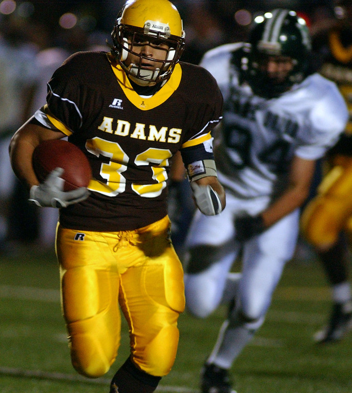 Description of . Rochester Adams High School football running back Beau Barterian runs away from the Lake Orion defense and scores a touchdown, during second quarter action, Friday, October 17, 2008, in a game played at Rochester Adams HS in Rochester Hills, Mich.  (The Oakland Press/Jose Juarez)