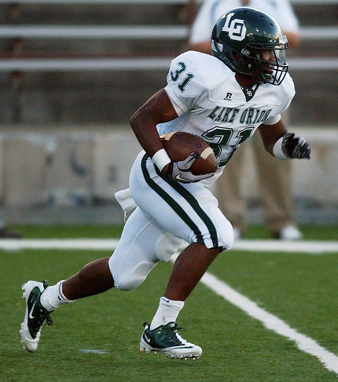 Description of . Lake Orion High School football player Marques Stevenson runs for yardage against Pontiac during second quarter action.  Photo taken on Friday, September 10, 2010, in a game played at Wisner Stadium in Pontiac, Mich.  (The Oakland Press/Jose Juarez)