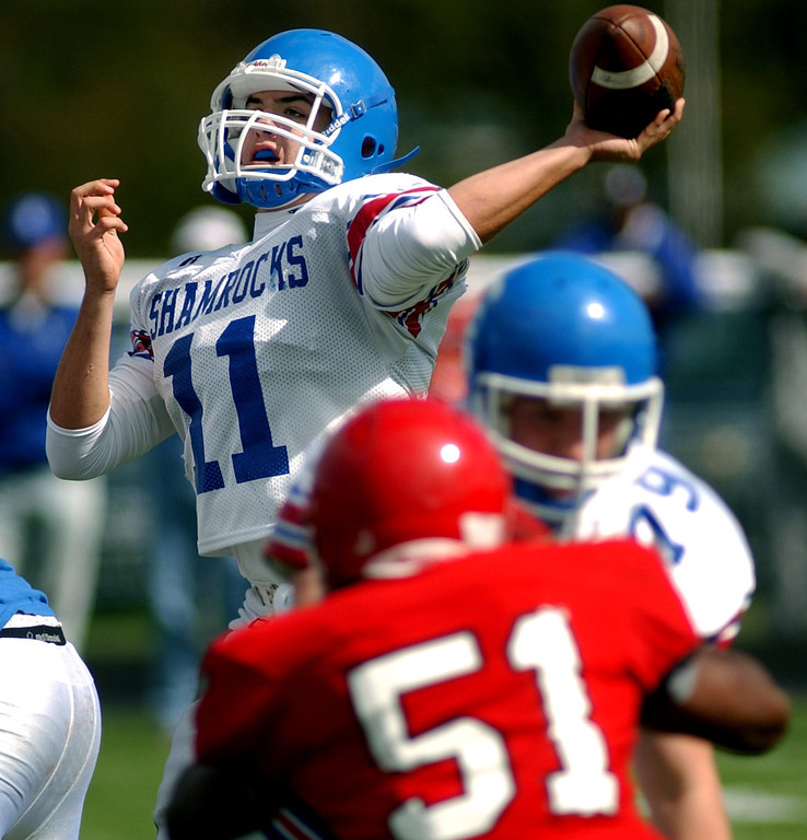 Description of . Novi Detroit Catholic Central High School football quarterback Sam Landry, top, fires a pass against Orchard Lake St. Mary's during second quarter action, Saturday, October 4, 2008, at OLSM HS in Orchard Lake, Mich.  (The Oakand Press/Jose Juarez)