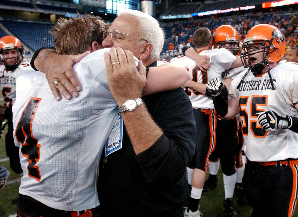 Description of . Birmingham Brother Rice High School football player Andy Lentz (left, #4) hugs head coach Al Fracassa after beating Hudsonville, 14-7, for the Division 2 state title, Friday, November 25, 2005, at Ford Field in Detroit, Mich.