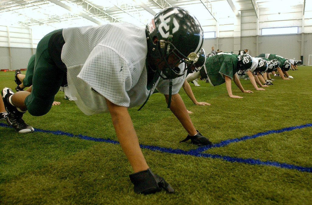 Description of . Lake Orion High School football practice.  Photo taken on Tuesday, November 25, 2008, in Pontiac, Mich.  (The Oakland Press/Jose Juarez)