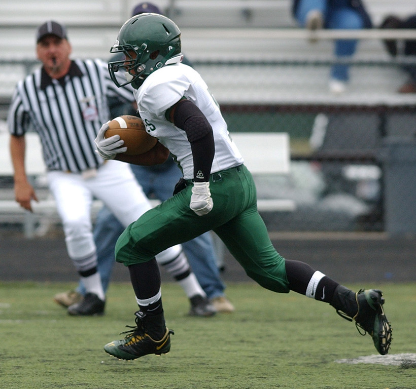 Description of . Birmingham Groves High School football player Keon Collier runs for yardage against Berkley during first quarter action.  Photo taken on Saturday, September 11, 2010, in a game played at Hurley Field in Berkley, Mich.  (The Oakland Press/Jose Juarez)
