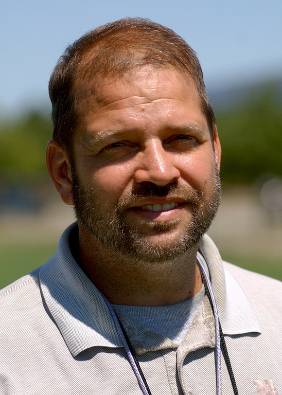 Description of . Novi High School football head coach-- Tab Kellepourey.  Photo taken on Tuesday, August 15, 2006, at Novi HS in Novi, Mich.  (The Oakland Press/Jose Juarez)