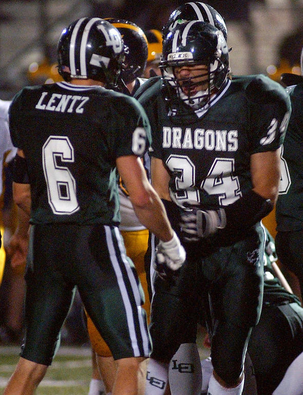Description of . Lake Orion High School football players Robby Lentz, left, and Evan Gros celebrate a defensive stop against Clarkston during second quarter action, Friday, October 24 2008, at Lake Orion HS in Lake Orion, Mich.  (The Oakland Press/Jose Juarez)