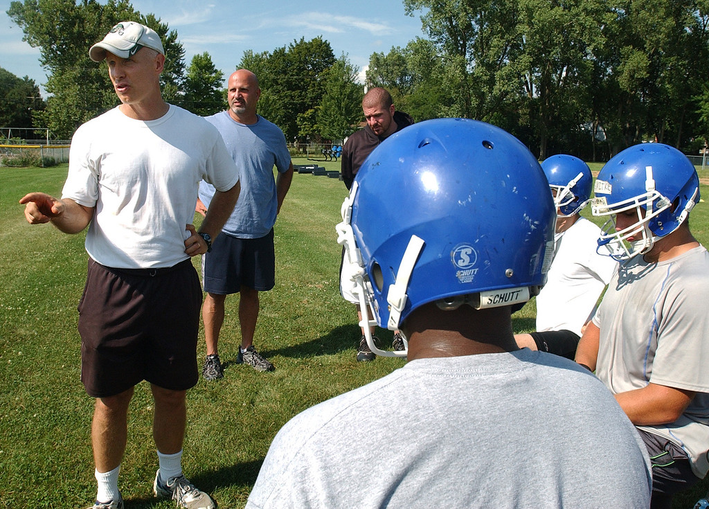 Description of . Southfield Christian High School football Head Coach Harold Marks, far left, addresses his team at the start of practice.  Photo taken on Tuesday, August 10, 2010, at Southfield Christian HS in Southfield, Mich.  (The Oakland Press/Jose Juarez)