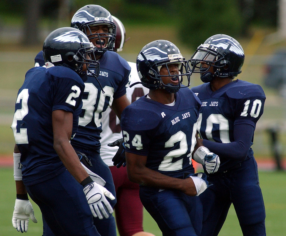 Description of . Southfield High School football defenseman Robert Drayton, second from right, and his teammates react after Drayton made a big hit against Birmingham Seaholm in the first quarter, Friday, September 5, 2008, at Southfield HS in Southfield, Mich.  (The Oakland Press/Jose Juarez)