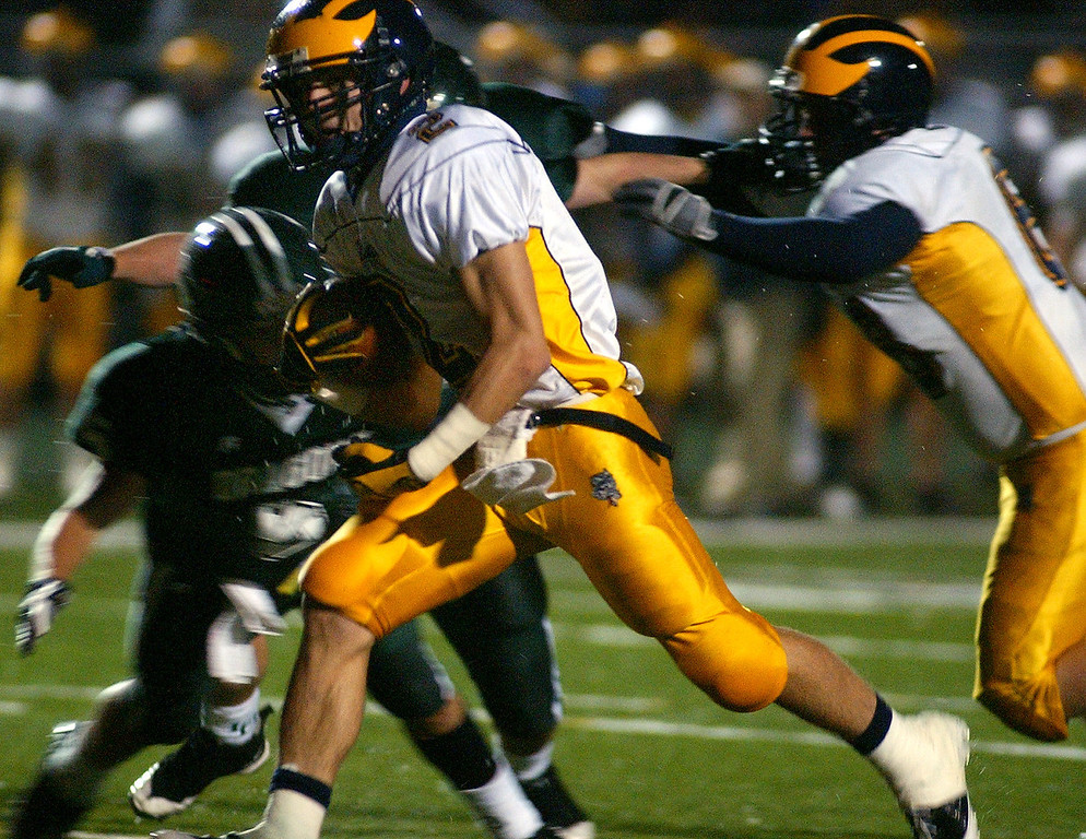 Description of . Clarkston High School football player Dakota Bender rushes in for a touchdown during first quarter action, Friday, October 24 2008, at Lake Orion HS in Lake Orion, Mich.  (The Oakland Press/Jose Juarez)