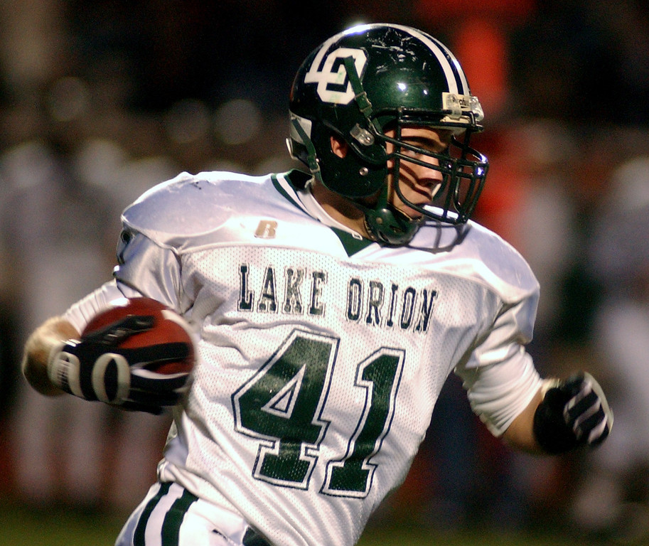 Description of . Lake Orion High School football player Eric Knoblock runs for yardage against Troy during second quarter action, Friday, October 3, 2008, at Troy HS in Troy, Mich.  (The Oakland Press/Jose Juarez)