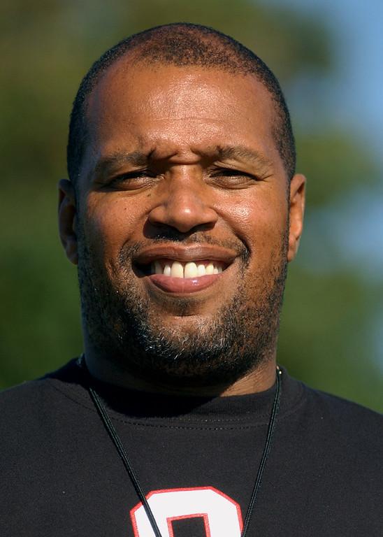 Description of . Oak Park High School football head coach-- Tim Hopkins.  Photo taken on Tuesday, August 15, 2006, at Oak Park HS in Oak Park, Mich.  (The Oakland Press/Jose Juarez)