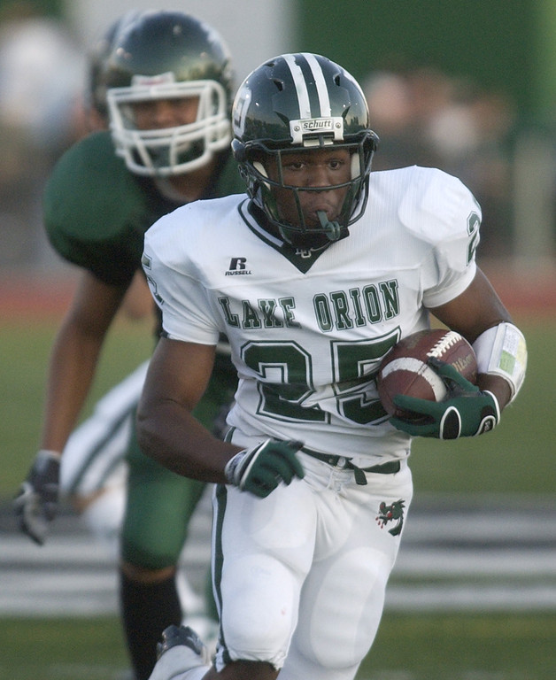 Description of . Lake Orion High School football player Kim Bruce runs for yardage against West Bloomfield, during second quarter action, Thursday, September 3, 2009, in a game played at West Bloomfield HS in West Bloomfield, Mich.  (The Oakland Press/Jose Juarez)