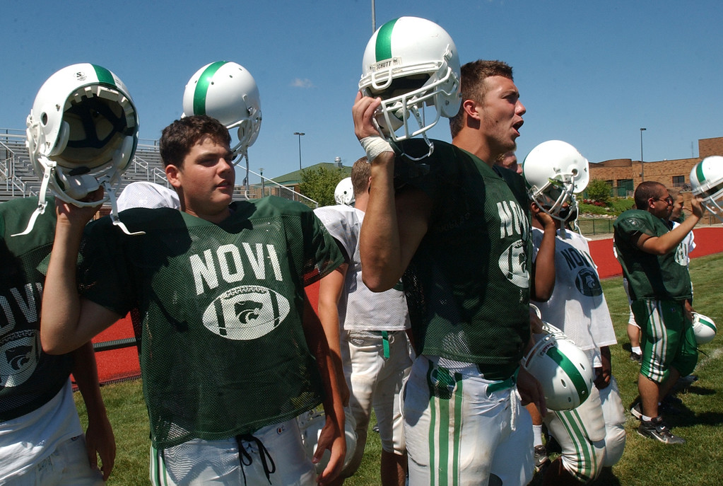 Description of . Novi High School football players cheer as their special teams unit practiced their kickoffs.  Photo taken on Tuesday, August 15, 2006, at Novi HS in Novi, Mich.  (The Oakland Press/Jose Juarez)
