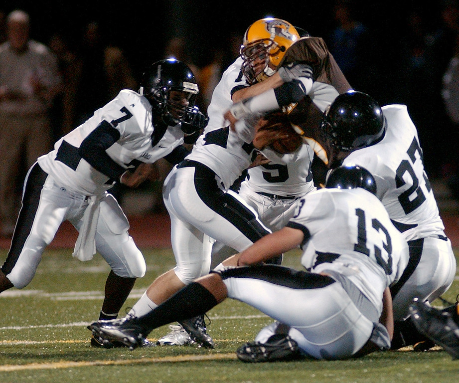 Description of . Several Bloomfield Hills Lahser High School football defenders gang up for a tackle on an unidentified Ferndale player during second quarter action, Friday, October 10, 2008, at Ferndale HS in Ferndale, Mich.  (The Oakland Press/Jose Juarez)