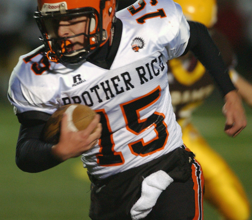 Description of . Birmingham Brother Rice High School football player Tyler Lendzion runs for yardage against Rochester Adams, during first quarter action.  Photo taken on Friday, November 6, 2009, in a game played at Rochester Adams HS in Rochester Hills, Mich.  (The Oakland Press/Jose Juarez)