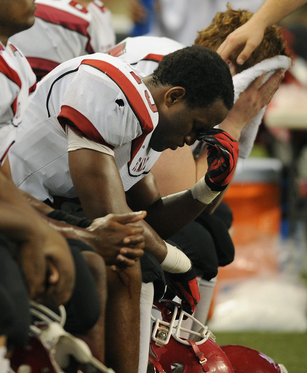 Description of . Orchard Lake St. Mary's High School football players sit dejectedly on the bench as their team was about to lose to East Grand Rapids, 24-21.  Photo taken on Saturday, November 28, 2009, in an MHSAA Division 3 football final held at Ford Field in Detroit, Mich.  (The Oakland Press/Jose Juarez)
