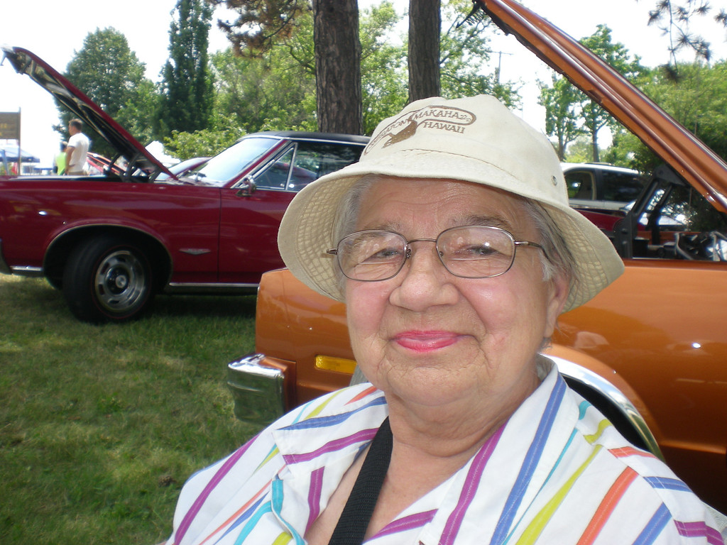 Description of . Irene Gawkowski of Livonia drove her cousin to Woodward Avenue to see Dream Cruise cars but didn't complain about missing her weekly pinochle game.