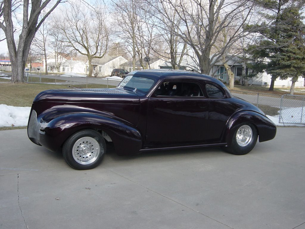 Description of . 1939 Buick series 40 coupe. The color is Black Cherry. It has been drastically modified..chopped ,shaved and lowered. It is powered by a 350/350 Chevrolet. SUBMITTED BY JIM JIDAS