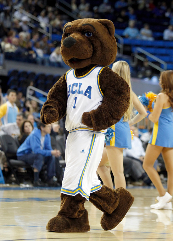Description of . UCLA mascot on the court in the second half of their NCAA college basketball game against Oakland Tuesday, Nov. 12, 2013, in Los Angeles. UCLA won the game 91-60.  (AP Photo/Alex Gallardo)