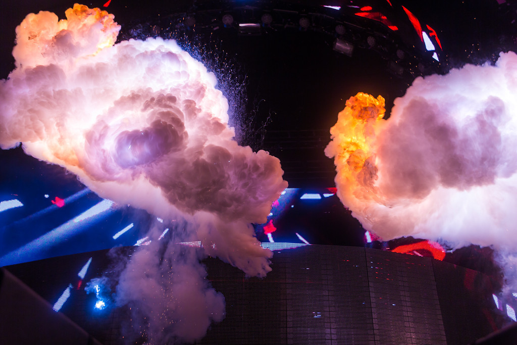Description of . While Steve Angello didn't leave his DJ Booth often, he did entertain the crowd with various forms of pyrotechnics and smoke blasts.