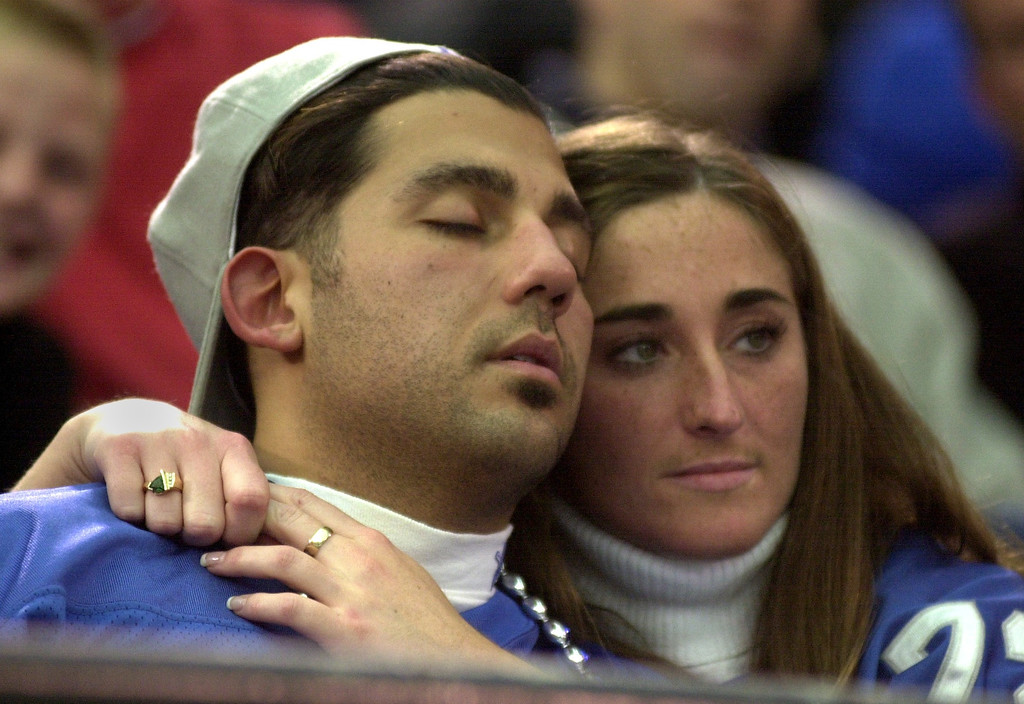 Description of . Nick Bondarek takes a nap while Tammy Johns, both of Port Huron, watch the Detroit Lions lose to the Tampa Bays Buccaneers 20-17 at the Pontiac Silverdome Sunday.