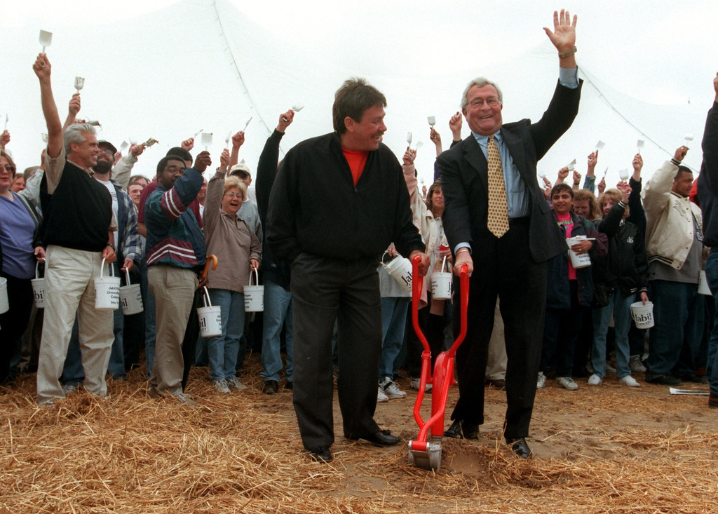 Description of . (f.left) Jabil Circuit  Chairman and CEO Bill Morean and Oakland County Executive L. Brooks Patterson celebrate during groundbreaking ceremonies marking the $40-million expansion of its Auburn Hills high-tech manufacturing operations.