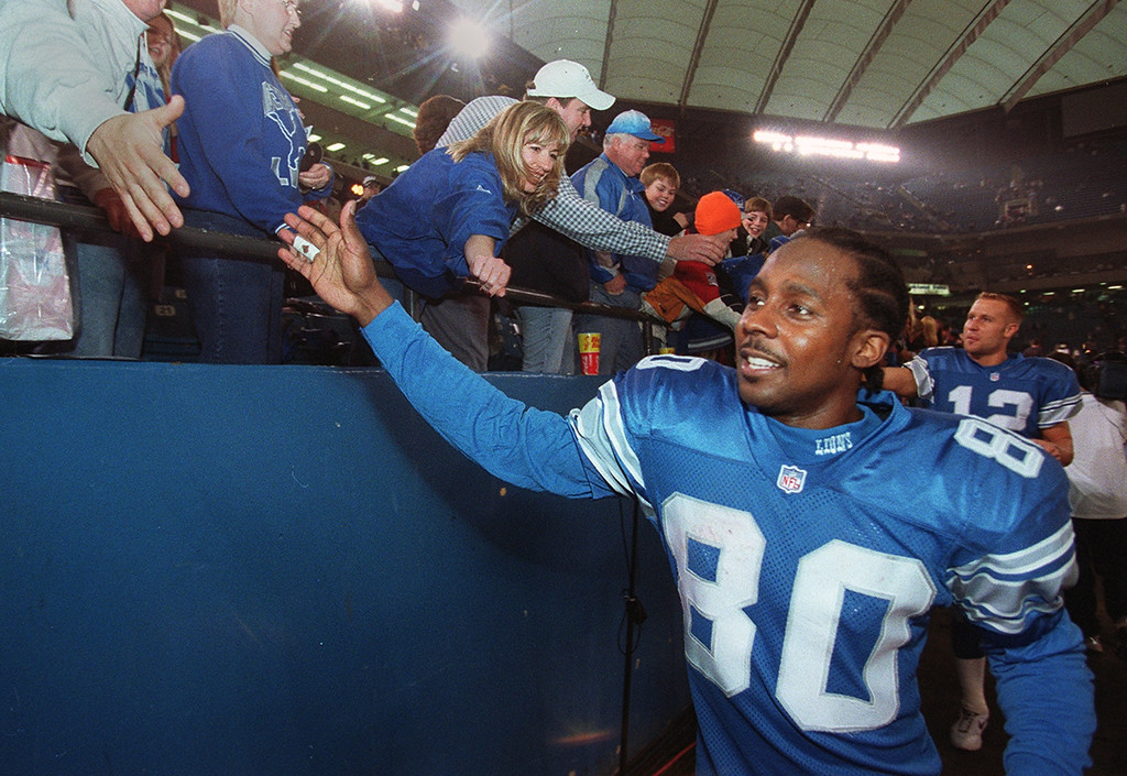 . Detroit Lions Desmond Howard slaps hands with fans after the Lions 15-10 victory over the Dallas Cowboys marking their last game at the Silverdome Sunday January 6, 2002.