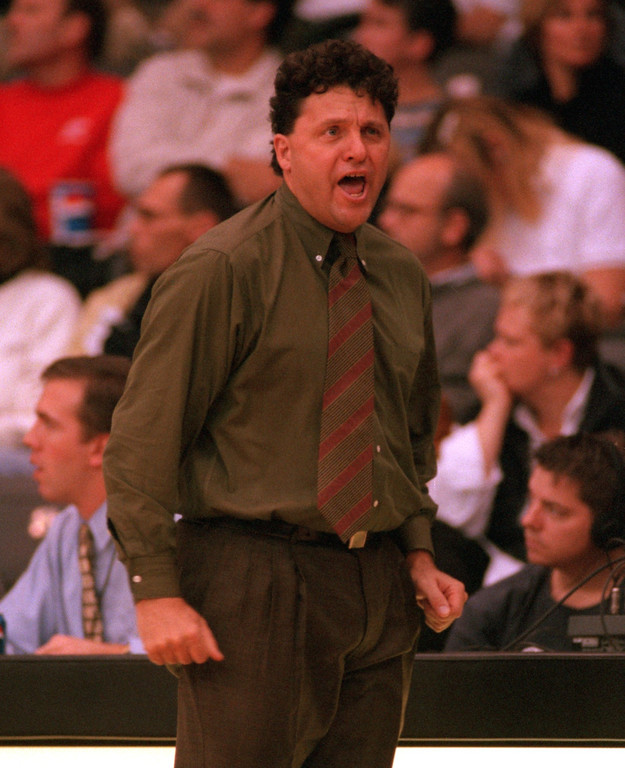 Description of . Oakland University mens' basketball head coach Greg Kampe reacts to a ref's foul call on his team during second half action against Illinois State University, Sunday, November 21, 1999.