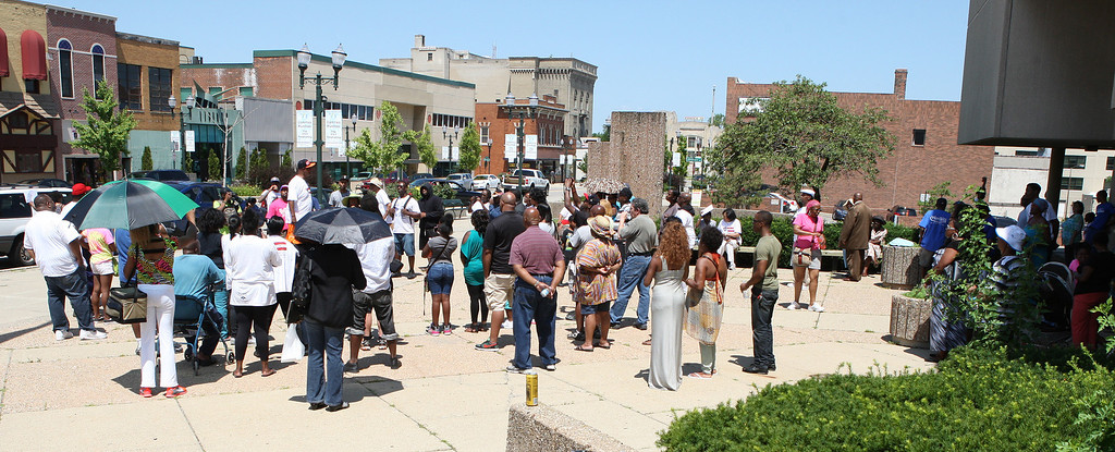Description of . MartinRally-4.07202013 Around 100 people turned out for the Rally for Justice for Trayvon Martin in front of the 50th District Court House in Pontiac Saturday, July 20, 2013. The rally and protest march were organized by the Pontiac Team for Justice. (Special to The Oakland Press / LARRY McKEE)